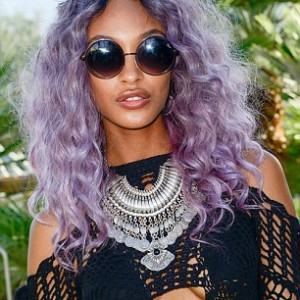 2782FE2400000578-3036692-Bold_She_teamed_her_new_purple_tresses_with_a_bold_playsuit_whic-m-77_1429105801514